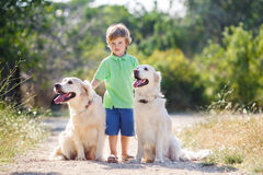 Boy with a dog on the nature Royalty Free Stock Images