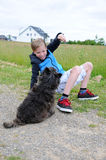 Boy and dog. Boy plays with his cairn terrier Stock Photos
