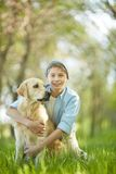 Boy with dog. Portrait of cute lad embracing his white Labrador Stock Photography