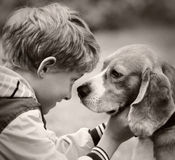 Boy and dog portrait vintage film shoot Royalty Free Stock Image