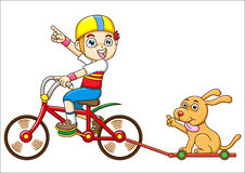 Boy and dog Riding a bicycle Royalty Free Stock Photo