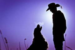 Boy & Dog Silhouette Royalty Free Stock Photos