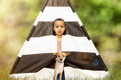 Boy and Dog in Tent Outdoors Royalty Free Stock Image
