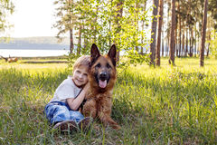 The boy and the dog for a walk Stock Photo