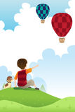 Boy and dog watching balloons Royalty Free Stock Photo