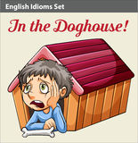 A boy in the doghouse. An idiom showing a boy in the doghouse royalty free illustration
