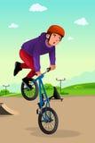 Boy doing a bike stunt. A vector illustration of boy doing stunt on a BMX bike Royalty Free Stock Photo