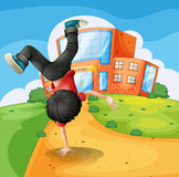 A boy doing breakdance along the school Royalty Free Stock Images