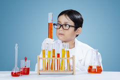 Boy doing chemical research with chemistry fluid Stock Images