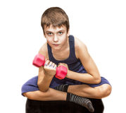 Boy doing exercises with dumbbells Stock Image