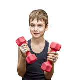 Boy doing exercises with dumbbells Royalty Free Stock Photo