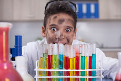 Boy doing experiments in the laboratory Royalty Free Stock Photos