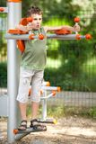 Boy doing fitness outdoor and having fun Stock Images