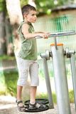 Boy doing fitness outdoor and having fun Stock Image