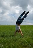 Boy doing handstand Stock Photos
