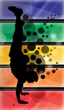 Boy doing a handstand. Silhouette of a boy doinf handstand with a colorful background behind Royalty Free Stock Photography