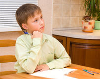 Boy doing his homework Royalty Free Stock Photos