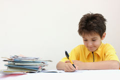 A boy doing his homework Stock Photo