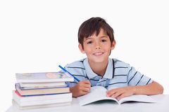 Boy doing his homework Royalty Free Stock Photos