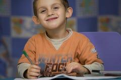 Boy doing his homework Stock Images