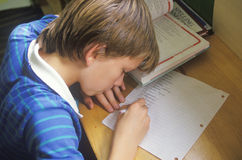 A boy doing his homework Royalty Free Stock Image