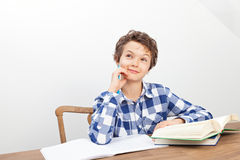 A boy is doing his homework. A handsome teenage boy is doing his homework royalty free stock image