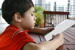 Boy doing his homework at home. Young boy doing his homework at home royalty free stock photo