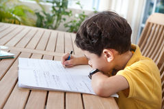 Boy doing his homework at home Stock Photo