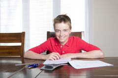 Boy doing his homework at home. A boy doing his homework at home Royalty Free Stock Images