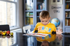 Boy doing his homework. At home Royalty Free Stock Photography