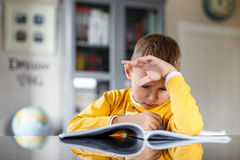Boy doing his homework. At home Royalty Free Stock Image