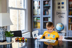 Boy doing his homework. At home Royalty Free Stock Photos