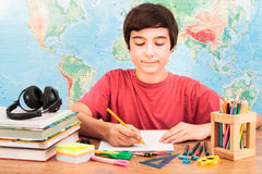 Boy doing his homework Stock Photos
