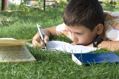 Boy doing home work Royalty Free Stock Image