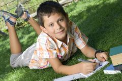 Boy doing home work Royalty Free Stock Images