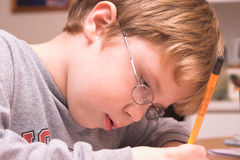 Boy Doing Homework. A young boy studying, doing his homework Royalty Free Stock Photography