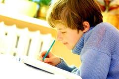 Boy doing homework Royalty Free Stock Image