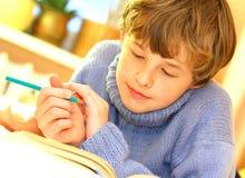Boy doing homework Stock Photography