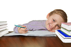 Boy doing homework. Smiling boy doing homework, isolated on white background Stock Photography