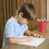 Boy doing homework. stock images