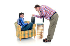 Boy doing homework. Young teenager boy doing studying and homework with father Stock Photos