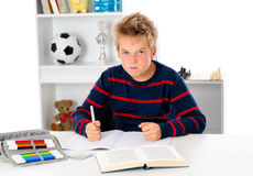 Boy is doing homework and is angry Royalty Free Stock Photos