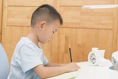 Boy doing homework Royalty Free Stock Photos