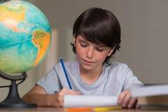 Boy doing homework Royalty Free Stock Photography