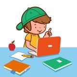 Boy doing homework on the computer Stock Photo