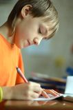 Boy is doing homework Royalty Free Stock Images