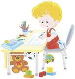 Boy doing homework after his game with toys. Little schoolboy writing in an exercise book with samples of letters, a vector illustration in a cartoon style Stock Photography
