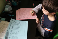 Boy doing homework. Boy doing his homework after school Stock Photo