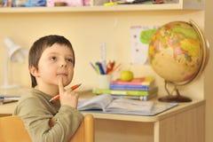 Boy doing homework at home Stock Photos