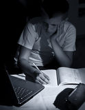 Boy doing homework with laptop Royalty Free Stock Photography